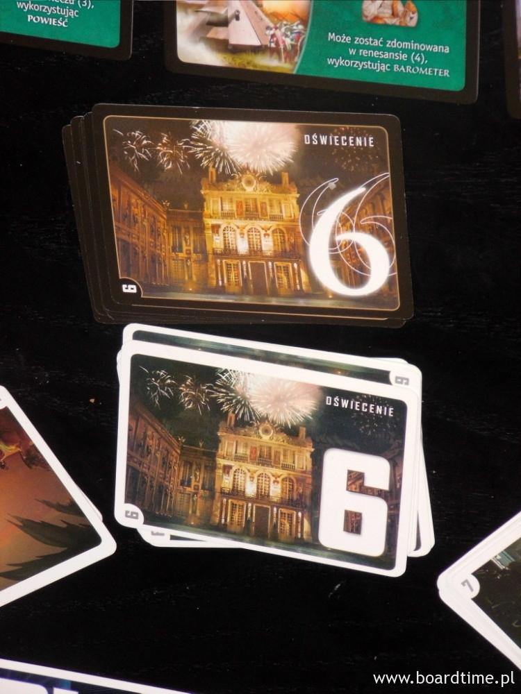 Karta z podstawki (biała ramka) na dole i karta z dodatku (ramka czarna)