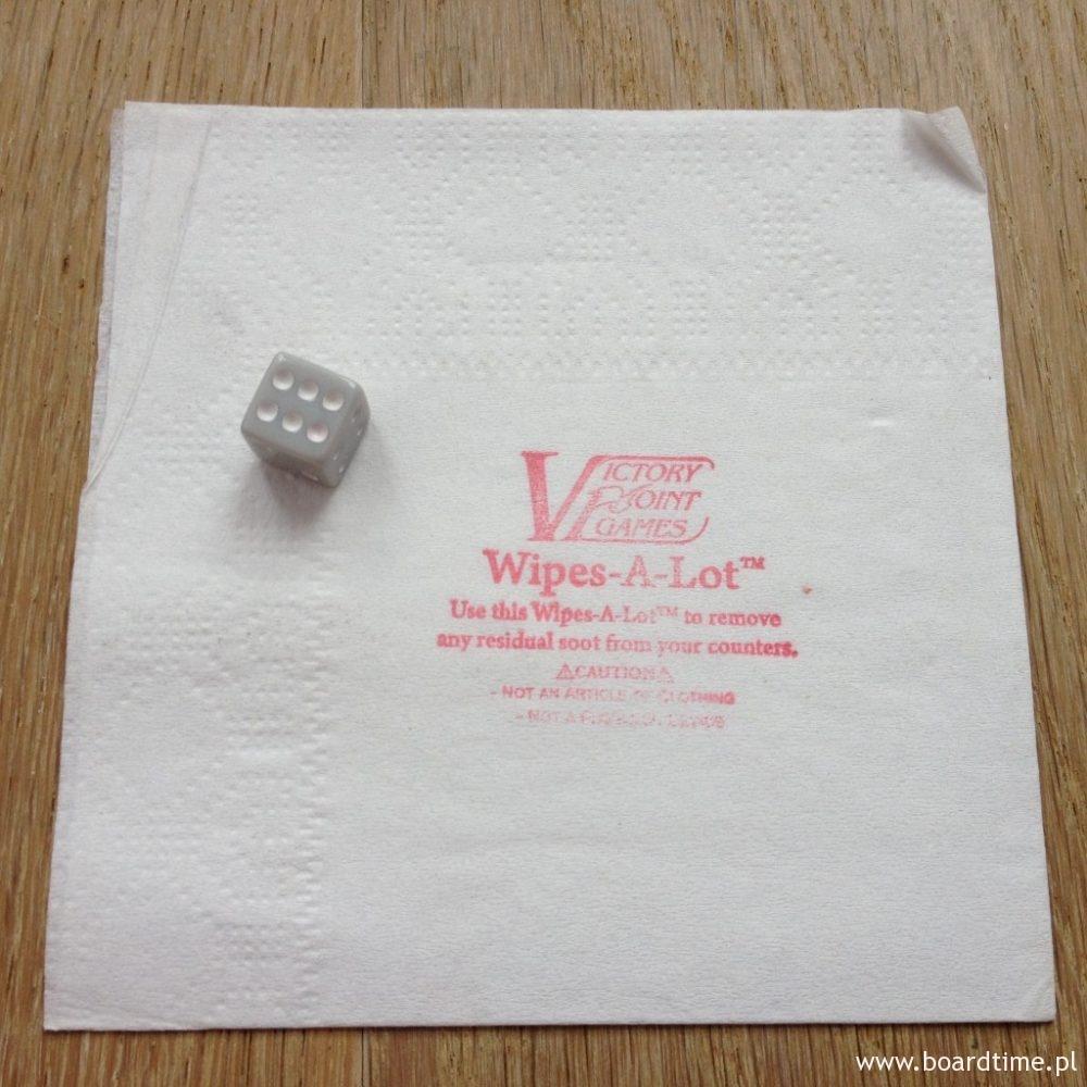 Kostka i znak rozpoznawczy gier VPG: papierowa ściereczka